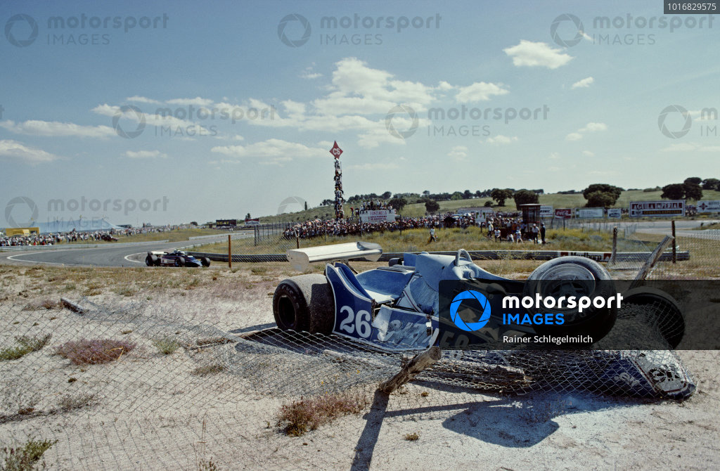 The Ligier JS11/15 Ford of Jacques Laffite is wrapped up in the catch fencing after crashing out of the race.