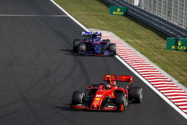 Charles Leclerc, Ferrari SF90, leads Alexander Albon, Toro Rosso STR14