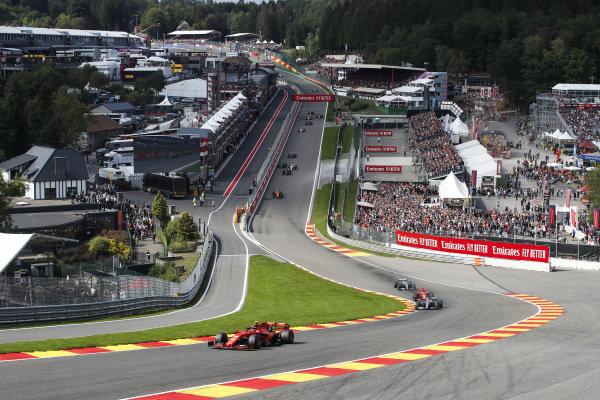 Charles Leclerc, Ferrari SF90, leads Lewis Hamilton, Mercedes AMG F1 W10 Sebastian Vettel, Ferrari SF90, and Valtteri Bottas, Mercedes AMG W10