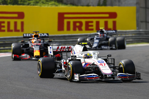 Mick Schumacher, Haas VF-21, leads Max Verstappen, Red Bull Racing RB16B, and Pierre Gasly, AlphaTauri AT02