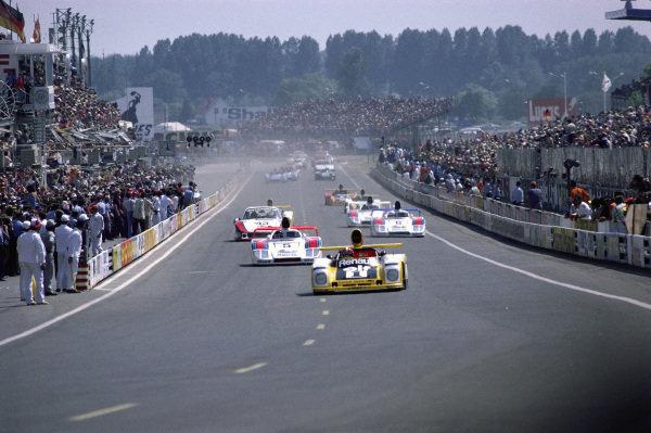 Jean-Pierre Jabouille / Patrick Depailler, Equipe Renault Elf Sport, Renault Alpine A443, leads Jacky Ickx / Henri Pescarolo / Jochen Mass, Martini Racing Porsche System, Porsche 936/78, at the start.