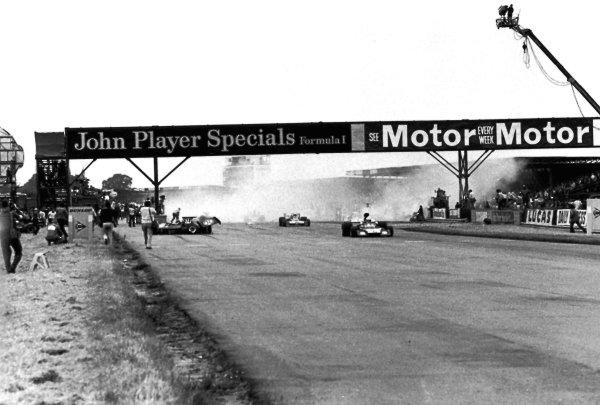 1973 British Grand Prix.Silverstone, England.12-14 July 1973.Jody Scheckter (McLaren M23 Ford) causes a multiple pile-up at the end of lap 1. Amazingly only Andrea de Adamich was injured.World Copyright - LAT Photographic