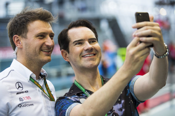 A Mercedes team member has his photo taken with Comedian Jimmy Carr