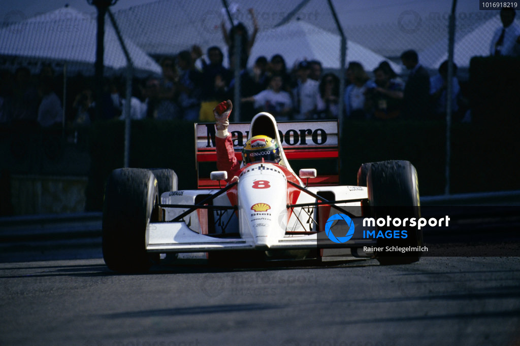 Ayrton Senna, McLaren MP4/8 Ford, celebrates victory on the slowing down lap.