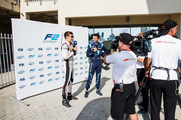 George Russell (GBR, ART Grand Prix), Alexander Albon (THA, DAMS) are interviewed.