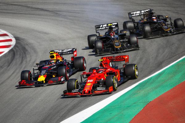 Charles Leclerc, Ferrari SF90, Pierre Gasly, Red Bull Racing RB15, Kevin Magnussen, Haas VF-19 and Romain Grosjean, Haas VF-19 battle