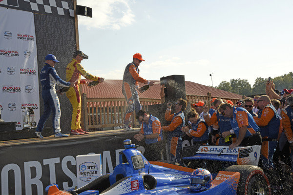 Felix Rosenqvist, Chip Ganassi Racing Honda, Scott Dixon, Chip Ganassi Racing Honda and Ryan Hunter-Reay, Andretti Autosport Honda spray champagne on the Ganassi racing crew