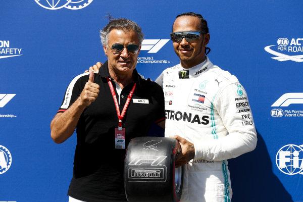 Pole sitter Lewis Hamilton, Mercedes AMG F1 receives the Pirelli Pole Position Award from Jean Alesi