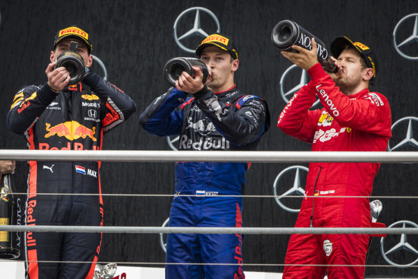 Race winner Max Verstappen, Red Bull Racing, Daniil Kvyat, Toro Rosso and Sebastian Vettel, Ferrari celebrate on the podium with the champagne