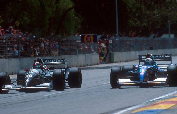 1994 Australian Grand Prix.Adelaide, Australia.11-13 November 1994.Heinz-Harald Frentzen (Sauber C13 Mercedes) dives down the inside of David Brabham (Simtek S941 Ford).Ref-94 AUS 55.World Copyright - LAT Photographic