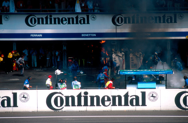 1994 German Grand Prix.Hockenheim, Germany.29-31 July 1994.Jos Verstappen (Benetton B194 Ford) came in for his pitstop. As the Refueller pulled the fuel hose away the valve stuck open allowing fuel to still come out of the nozzle and over the car which ignited into a huge fireball. The fire was delt with quite swiftly though.Ref-94 GER 49.World Copyright - LAT Photographic