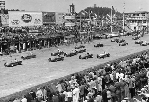 1953 German Grand Prix.  Nurburgring, Germany. 2nd August 1953. Juan Manuel Fangio (Maserati A6GCM), 2nd position, leads at the start of the race, action. World Copyright: LAT Photographic