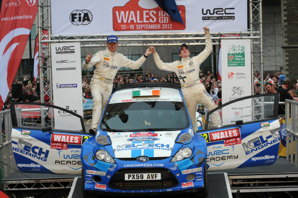Craig Breen (IRL) and Paul Nagle (IRL), Ford Fista S2000 dedicates his win to Gareth Roberts (GBR) on the podium.FIA World Rally Championship, Rd10, Wales Rally GB, Day Three, Cardiff, Wales, 16 September 2012.