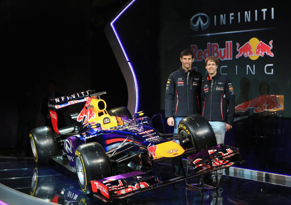 Milton Keynes, UK   Drivers Mark Webber of Australia (L) and Sebastian Vettel of Germany pose along side the new car Photo: Richard Heathcote/Getty Images/Red Bull Racing () ref: Digital Image 160594804
