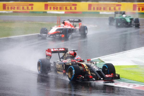 Suzuka Circuit, Suzuka, Japan.  Sunday 5 October 2014. Romain Grosjean, Lotus E22 Renault, leads Jules Bianchi, Marussia MR03 Ferrari. World Copyright: Charles Coates/LAT Photographic. ref: Digital Image _J5R5054
