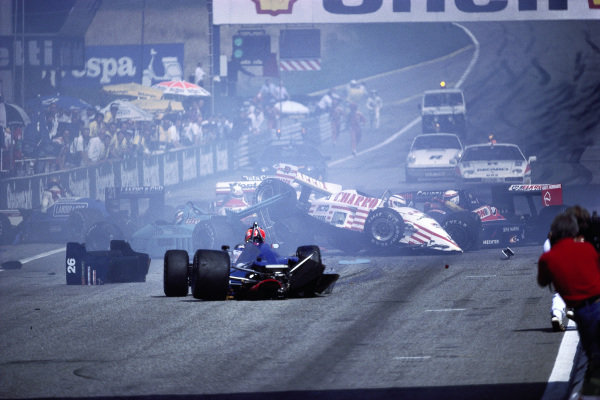 Crash at the second start with Pascal Fabre, AGS JH22 Ford, ending up on top of Ivan Capelli's March 871 Ford, and Piercarlo Ghinzani, Ligier JS29C Megatron, in the middle of the track, as Alex Caffi, Osella FA1I Alfa Romeo, and Philippe Alliot, Lola LC87 Ford, climb out.