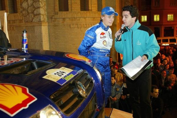 Jutta Kleinschmidt (GER) VW is interviewed on the start ramp.Dakar Rally, Stage 2, Narbonne to Castell'n, 2 January 2004.DIGITAL IMAGE