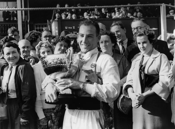 Aintree, England. 2nd October 1954.Stirling Moss (Maserati 250F), 1st position, podium, portrait. World Copyright: LAT PhotographicRef:  Autocar Used Pic 8th October 1954 Pg 511.