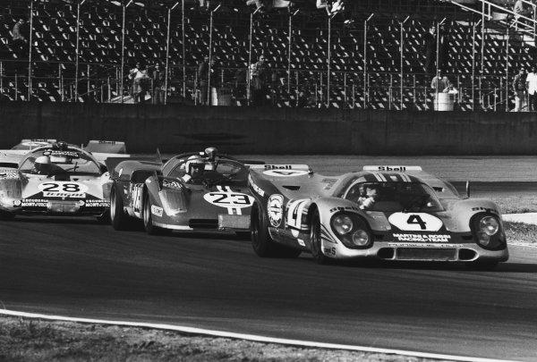 1971 Daytona 24 Hours. Daytona, Florida, USA. 30th - 31st January 1971. Rd 2. Vic Elford / Gijs van Lennep (Porsche 917K), retired, leads Ronnie Bucknum / Tony Adamowicz (Ferrari 512 S Spyder), 2nd position and Arturo Merzario / Jose Juncadella (Ferrari 512 S), retired, action.  World Copyright: LAT Photographic. Ref: 3496 - 34-34A.