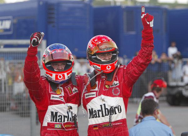 2004 Hungarian Grand Prix - Sunday Race, Budapest, Hungary. 15th August 2004 Michael Schumacher, Ferrari F2004 (1st) and Rubens Barrichello, Ferrari F2004 (2nd) celebrate clinching the 2004 constructors championship.World Copyright: Steve Etherington/LAT Photographic ref: Digital Image Only
