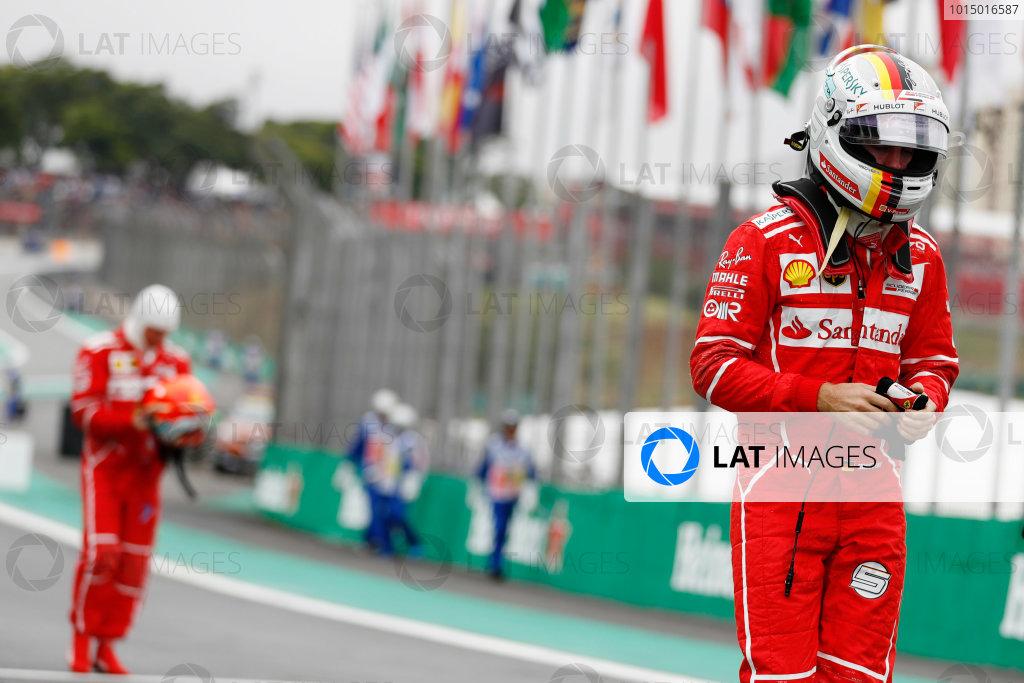 Interlagos, Sao Paulo, Brazil. Saturday 11 November 2017. Sebastian Vettel, Ferrari, and Kimi Raikkonen, Ferrari, walk back into the pits after qualifying, World Copyright: Glenn Dunbar/LAT Images  ref: Digital Image _31I2605