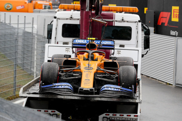 Car of Lando Norris, McLaren MCL34 on the back of a low loader
