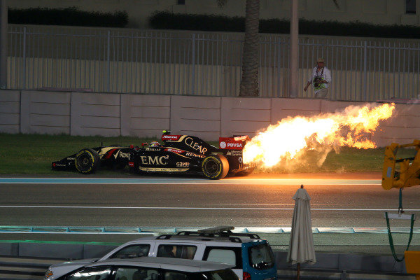 Pastor Maldonado (VEN) Lotus E22 retires with an engine fire. Formula One World Championship, Rd19, Abu Dhabi Grand Prix, Race, Yas Marina Circuit, Abu Dhabi, UAE, Sunday 23 November 2014.  BEST IMAGE