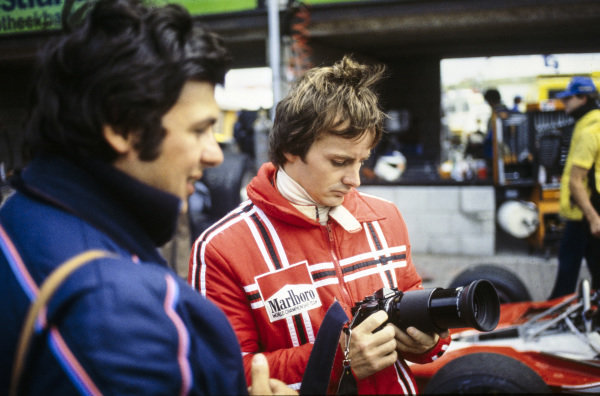 Gilles Villeneuve takes a look at Ercole Colombo's camera.