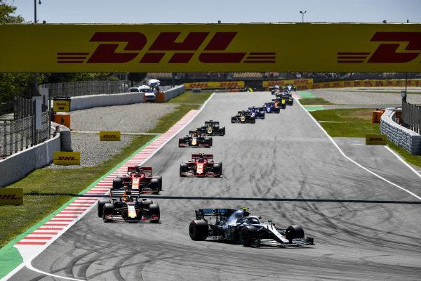 Valtteri Bottas, Mercedes AMG W10, leads Max Verstappen, Red Bull Racing RB15, Sebastian Vettel, Ferrari SF90, Charles Leclerc, Ferrari SF90,Pierre Gasly, Red Bull Racing RB15, and Romain Grosjean, Haas VF-19