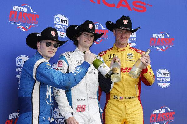 Colton Herta, Harding Steinbrenner Racing Honda, Josef Newgarden, Team Penske Chevrolet, Ryan Hunter-Reay, Andretti Autosport Honda celebrate on the podium with a toast