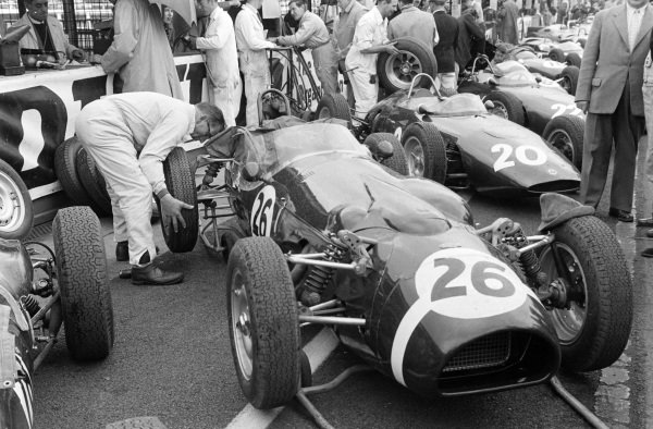 Jack Fairman/Stirling Moss' Ferguson P99 Climax is serviced by a mechanic in the pits.