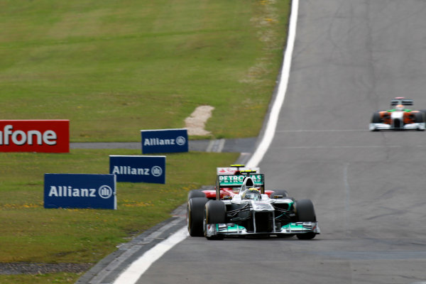 Nurburgring, Germany24th July 2011Nico Rosberg, Mercedes GP W02, 7th position, leads Felipe Massa, Ferrari 150° Italia, 5th position. Action. World Copyright:Glenn Dunbar/LAT Photographicref: Digital Image C27C4543