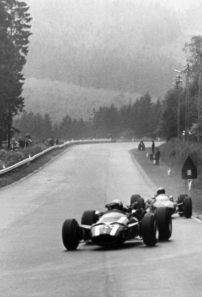 1966 Belgian Grand Prix.Spa-Francorchamps, Belgium. 12 June 1966.Richie Ginther, Cooper T81-Maserati, 5th position, leads Lorenzo Bandini, Ferrari 158/246, 3rd position, action.World Copyright: LAT PhotographicRef: b&w print