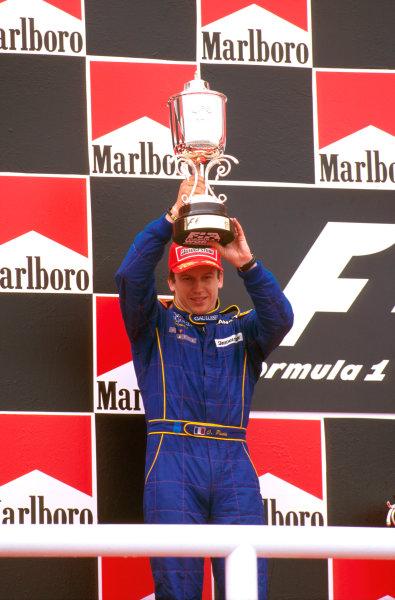 Barcelona, Spain.23-25 May 1997.Olivier Panis (Prost Mugen Honda) celebrates 2nd position on the podium.Ref-97 ESP 02.World  Copyright - LAT Photographic