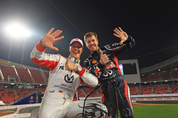 (L to R); Michael Schumacher (GER) Mercedes AMG F1 and Sebastian Vettel (GER) Red Bull Racing celebrate Team Germany winning their sixth consecutive RoC Nations Cup. Race of Champions, Rajamangala National Stadium, Bangkok, Thailand, 15-16 December 2012.