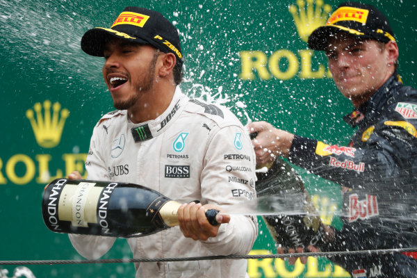 Interlagos, Sao Paulo, Brazil. Sunday 13 November 2016. Lewis Hamilton, Mercedes AMG, sprays champagne with Max Verstappen, Red Bull, on the podium. World Copyright: Glenn Dunbar/LAT Photographic ref: Digital Image _X4I8468