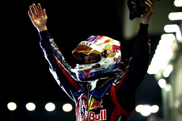 Marina Bay Circuit, Singapore.25th September 2011.Sebastian Vettel, Red Bull Racing RB7 Renault, 1st position, celebrates victory in Parc Ferme. Portrait. Helmets. Finish. World Copyright: Andy Hone/LAT Photographicref: Digital Image CSP28765