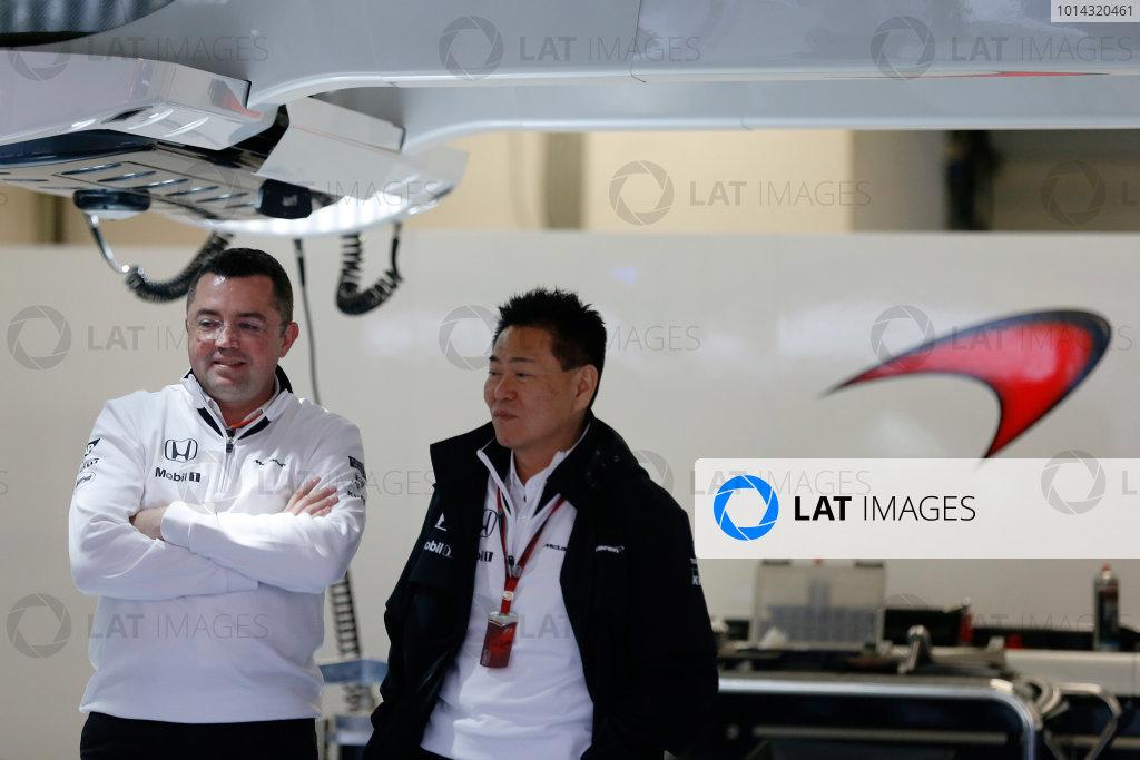Shanghai International Circuit, Shanghai, China. Thursday 9 April 2015. Yasuhisa Arai, Head of Motorsport, Honda, and Eric Boullier, Racing Director, McLaren. World Copyright: Charles Coates/LAT Photographic. ref: Digital Image _J5R6590