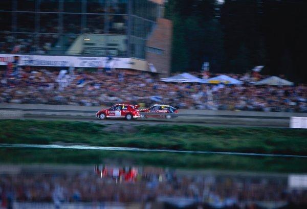 2003 World Rally ChampionshipRally of Finland, Finland. 6th - 10th August 2003Harri Rovanpera / Risto Pietilainen (Pugeot 206 WRC), Sebastien Loeb / Daniel Elena (Citroen Xsara)World Copyright: McKLEIN/LATref: 35mm Image 03FINLAND02