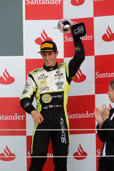 Round 4. Silverstone, Northamptonshire, England. 10th July 2011.Sunday Race.Alexander Sims, (GBR, Status Grand Prix) on the podium. Portrait. Photo: Andrew Ferraro/GP3 Media Service.    ref: Digital Image _Q0C9366