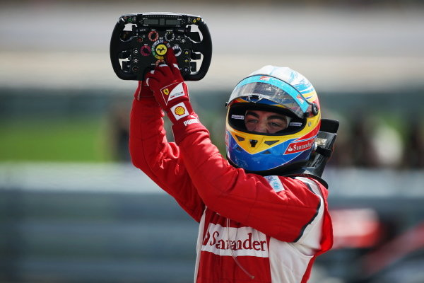 Race winner Fernando Alonso (ESP) Ferrari celebrates in parc ferme. Formula One World Championship, Rd 9, British Grand Prix, Race, Silverstone, England, Sunday 10 July 2011.  BEST IMAGE