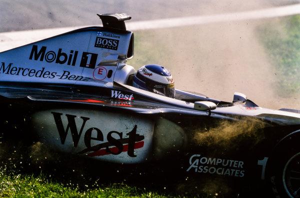 1999 Italian Grand Prix. Monza, Italy. 10th - 12th September 1999. Mika Hakkinen (McLaren MP4/14-Mercedes), retired action.  World Copyright: LAT Photographic.  Ref:  99ITA