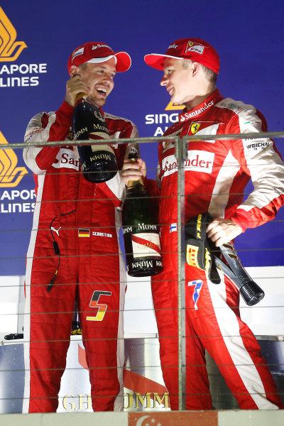 Marina Bay Circuit, Singapore. Sunday 20 September 2015. Sebastian Vettel, Ferrari, 1st Position, and Kimi Raikkonen, Ferrari, 3rd Position, celebrate on the podium. World Copyright: Alastair Staley/LAT Photographic ref: Digital Image _79P4077