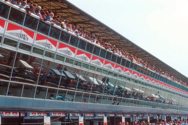 Monza, Italy.8-10 September 1995.The grandstand above the pits complex is crowded by the fans.Ref-95 ITA 23.World Copyright - LAT Photographic