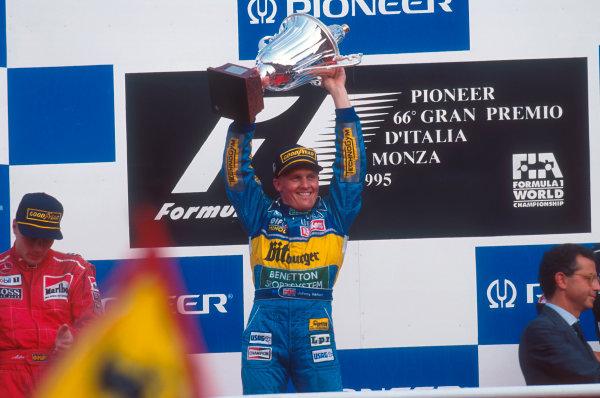 Monza, Italy.8-10 September 1995.Johnny Herbert (Benetton Renault) celebrates 1st position on the podium.Ref-95 ITA 08.World Copyright - LAT Photographic