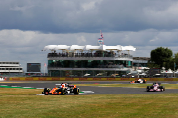 Silverstone, Northamptonshire, UK.  Friday 14 July 2017. Fernando Alonso, McLaren MCL32 Honda, leads Sergio Perez, Force India VJM10 Mercedes. World Copyright: Zak Mauger/LAT Images  ref: Digital Image _54I4354