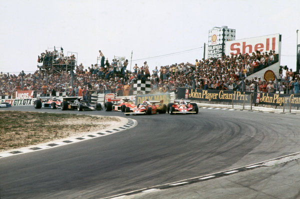 Brands Hatch, England. 16th - 18th July 1976. Clay Regazzoni (Ferrari 312T2), Disqualified, crashes into Niki Lauda (Ferrari 312T2), 1st position, at the top of Paddock Hill Bend with James Hunt (McLaren M23-Ford), Disqualified, causing the race to be stopped, action. World Copyright: LAT Photographic. Ref:  76 GB 03
