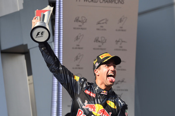 Race winner Daniel Ricciardo (AUS) Red Bull Racing celebrates on the podium with the trophy at Formula One World Championship, Rd16, Malaysian Grand Prix, Race,  Sepang, Malaysia, Sunday 2 October 2016.