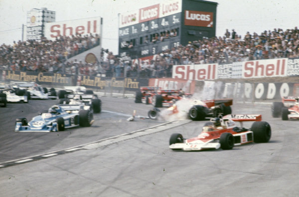 Clay Regazzoni, Ferrari 312T2 spins at the start, causing a red flag and a restart.
