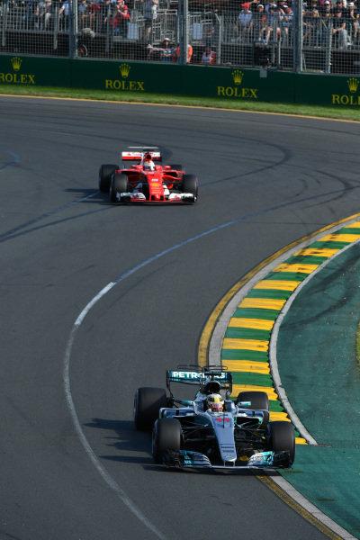 Lewis Hamilton (GBR) Mercedes-Benz F1 W08 Hybrid leads Sebastian Vettel (GER) Ferrari SF70-H at Formula One World Championship, Rd1, Australian Grand Prix, Race, Albert Park, Melbourne, Australia, Sunday 26 March 2017.